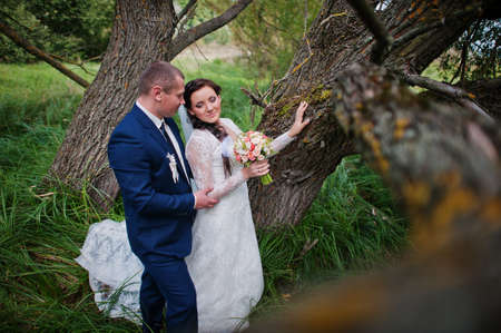 multi story: Wedding couple in high grass and near tree