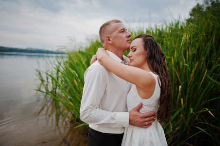 bullrush: couple at lake on water near bullrush