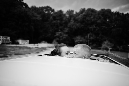 sunroof: couple kissing at the car sunroof