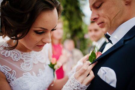 buttonhole: bride groom wears a buttonhole