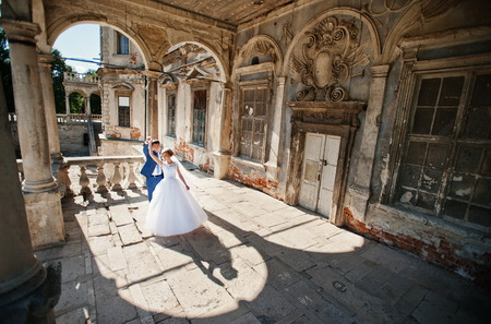 Tender wedding couple background old architecture of castle Imagens