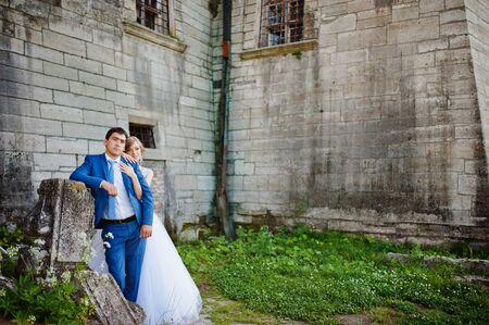 couple background: Tender wedding couple background old architecture of castle Stock Photo