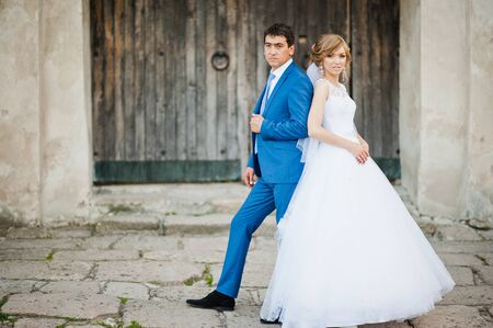 pompous: Tender wedding couple background old architecture of castle Stock Photo