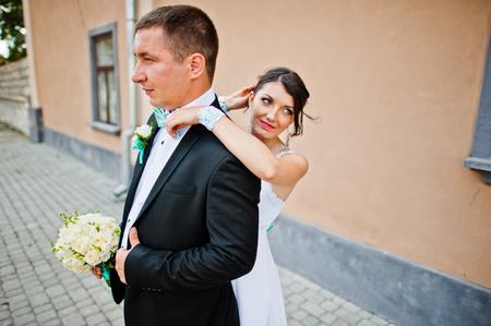 couple background: wedding couple background stone wall with windows Stock Photo