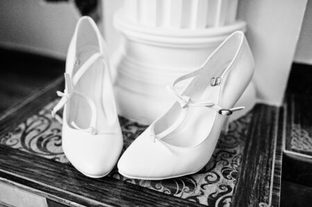 festal: white bridal shoes on decor background