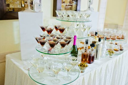 vermouth: Glasses with vermouth  and drinks on wedding reception
