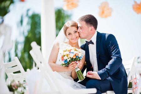 happy wedding: happy fashionable wedding couple on wedding ceremony of registration Stock Photo