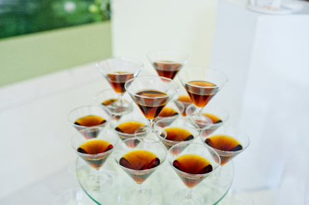 Glasses with red vermouth on wedding reception