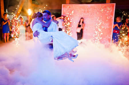 Amazing first wedding dance on heavy smoke