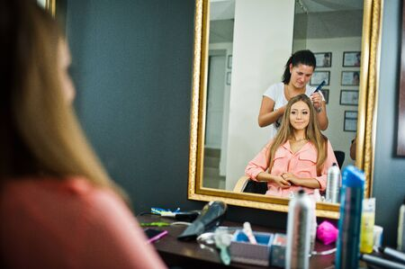 bridal salon: Stylist applying make up for bride on the wedding day