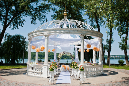 wedding arch with chairs and many flowers and decor Foto de archivo