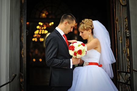 buttonhole: Bride at the exit of the church groom buttonhole buttons Stock Photo
