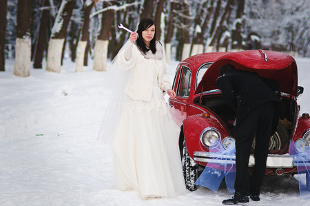 couple winter: Wedding couple in winter near old vintage car Stock Photo