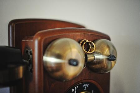 antique phone: wedding rings on antique phone Stock Photo