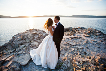 wedded: Very sensual and gorgeus wedding couple on the picturesque landscapes on sunset