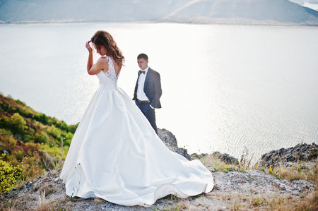 couple married: Very sensual and gorgeus wedding couple on the picturesque landscapes