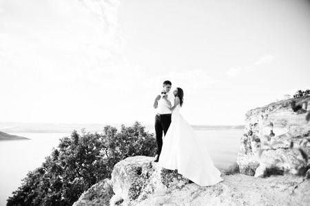 love story: Very sensual and gorgeus wedding couple on the picturesque landscapes