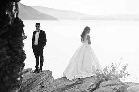 love story: Very sensual and gorgeus wedding couple on the picturesque landscapes on sunset