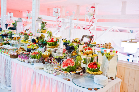 tiered: Wedding reception. Table with fruits and sweets Stock Photo