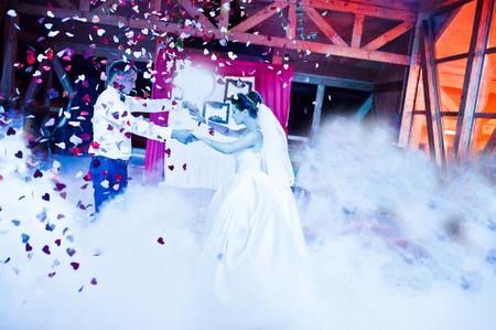 Wedding dance in restaurant with varioius lights and smoke Stock Photo - 48368042