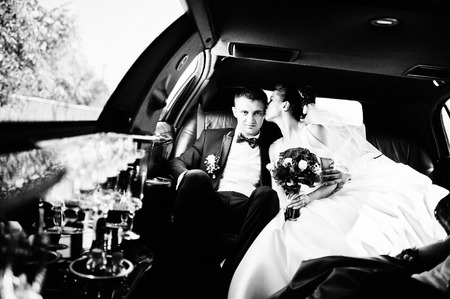 limousine: wedding couple indoor the limousine