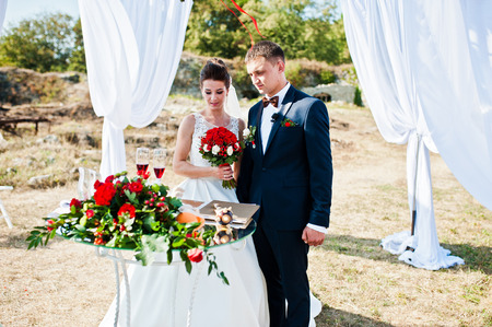 arranging chairs: Newlyweds on wedding ceremony at sunny day