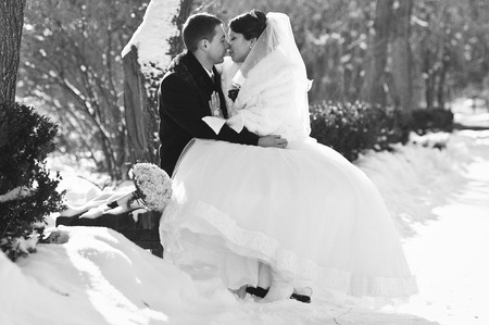 winter wedding: Young wedding couple at sunny winter day