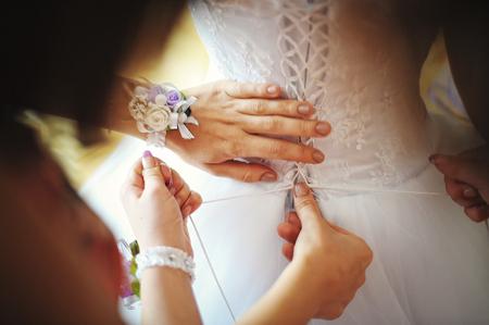 bridesmaid: Bridesmaid wearing dress of bride