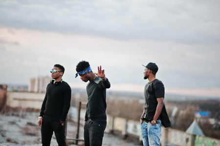 street shots: Three rap singers band on the roof Stock Photo