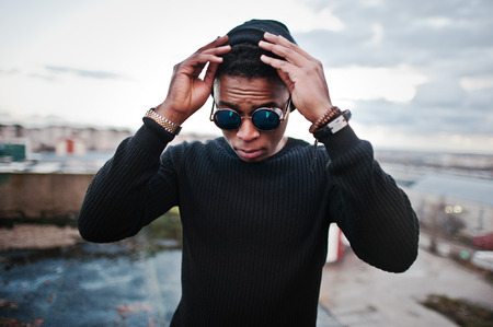 glasses model: Portrait of  style black man on the roof