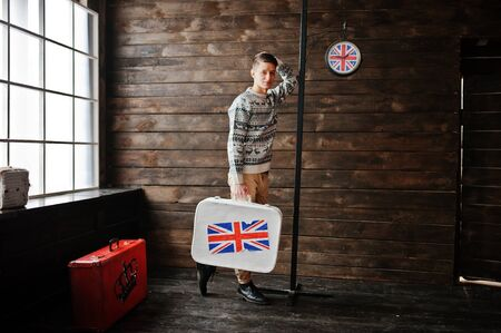 british man: Young fashion man with the suitcase with the British flag