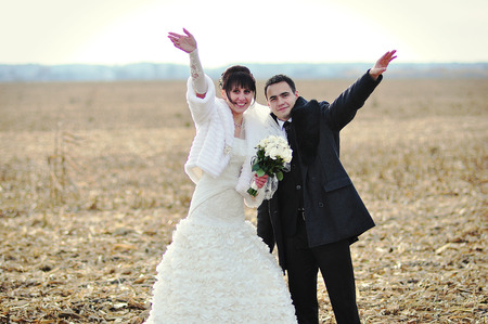 smiled: Happy and smiled wedding couple on corn field Stock Photo