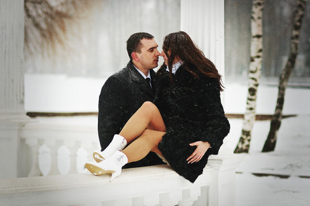 in loved: Young loved couple on winter snowly day
