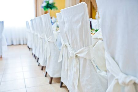 wedding chairs: White wedding chairs on restaurant Stock Photo