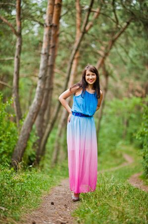 posed: Young beautiful and cute girl posed at pine forest Stock Photo