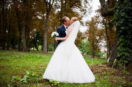 vegetation: Wedding couple near the old trees overgrown vegetation Stock Photo