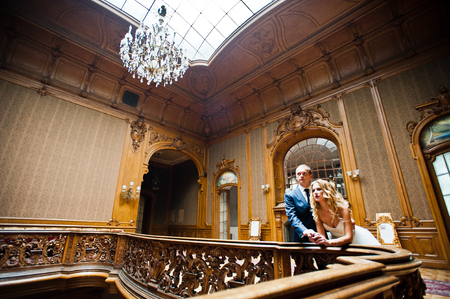 home decorations: Elegant wedding couple at old vintage house and palace with big wooden stairs Stock Photo