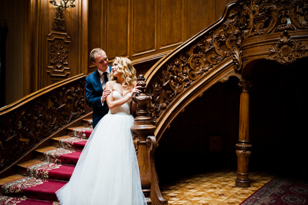 house with style: Elegant wedding couple at old vintage house and palace with big wooden stairs Stock Photo