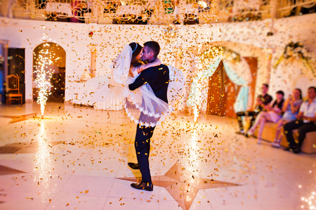 First wedding dance of newlyweds on restaurant with fireworks