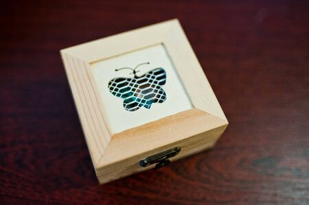buterfly: Wooden decorated box with buterfly with wedding rings