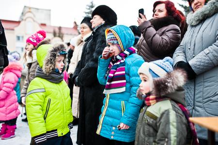 UKRAINE. LVIV - JANUARY 14, 2016: Christmas nativity scene parade of children on winter day.