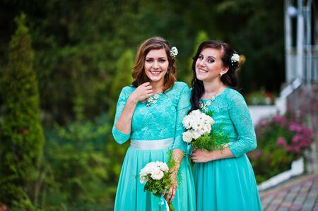 turqoise: Bridesmaids on turqoise dresses outdoor