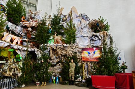 animal angelic: Very large christmas nativity crib. War soldier ATO Stock Photo