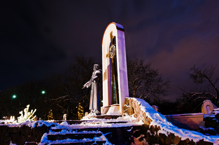 francis: monument of St. Francis at frozen evening