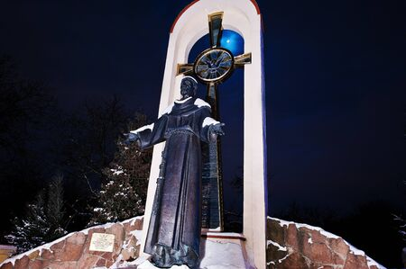st francis: monument of St. Francis at frozen evening