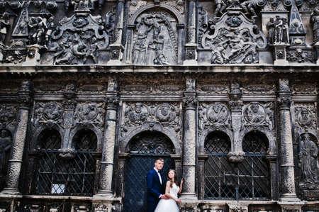 pompous: Wedding couple near old architecture