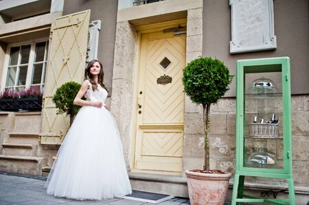 posed: Bride posed near vintage house