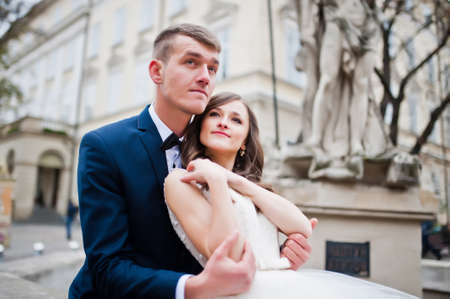 siting: Wedding couple siting near Poseidon monument