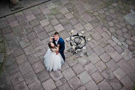 Wedding couple. Photo from quad copter drone view Foto de archivo