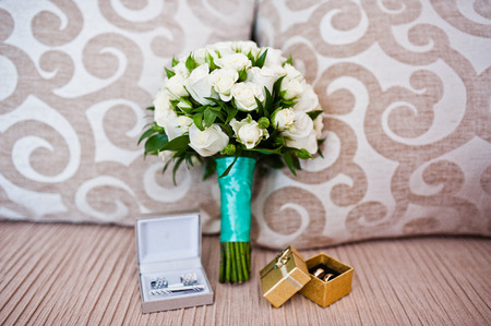 cuff links: Wedding bouquet with boxes with rings and cuff links Stock Photo
